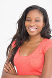 Pretty designer smiling at camera in front of whiteboard Royalty Free Stock Photo