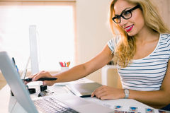 Pretty designer working at her desk Royalty Free Stock Images