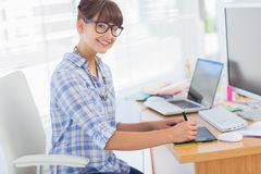 Pretty designer working on her graphics tablet Royalty Free Stock Images