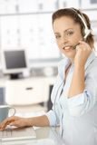 Pretty dispatcher working in bright office smiling Stock Photography