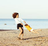 Pretty diverse nation and age friends on sea coast having fun, l Stock Images