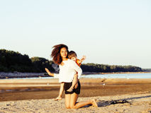 Pretty diverse nation and age friends on sea coast having fun, lifestyle people concept on beach vacations Stock Image