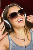 Pretty dj smiling and dancing Royalty Free Stock Images