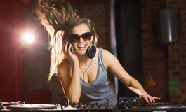 Pretty dj smiling and dancing Stock Images