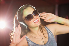 Pretty dj smiling and dancing Royalty Free Stock Photo