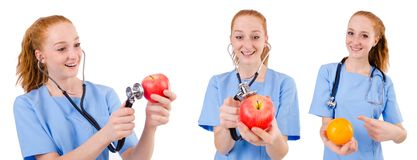 Pretty doctor  in blue uniform with stethoscope and apple  isola Royalty Free Stock Photography