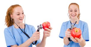 Pretty doctor  in blue uniform with stethoscope and apple  isola Stock Image