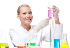 Pretty doctor keeps a beaker Stock Images