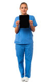 Pretty doctor showcasing a portable tablet Royalty Free Stock Image