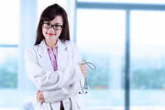 Pretty doctor smiling Stock Photo