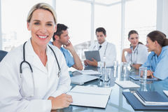 Pretty doctor smiling to the camera Stock Photo