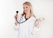 Pretty doctor with stethoscope Stock Image