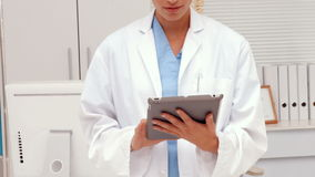 Pretty doctor using tablet pc. In ultra hd format stock video