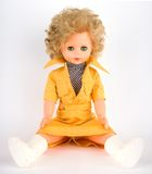 Pretty doll. Vintage pretty doll against yellow background Royalty Free Stock Image