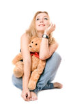 Pretty dreamy blonde with a teddy bear Stock Photo
