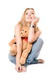 Pretty dreamy blonde with a teddy bear Stock Photo