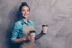 Pretty, dreamy, charming girl holds disposable cup with drinks a stock photo
