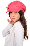 Pretty eight year old girl blowing kiss stock photo