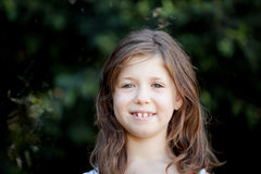 Pretty eight year old girl in the park Royalty Free Stock Photography