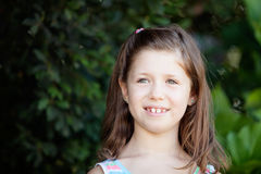 Pretty eight year old girl in the park Royalty Free Stock Photo