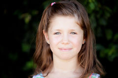 Pretty eight year old girl in the park Stock Photo