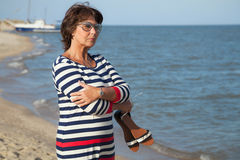 Pretty elderly woman on vacation at seaside Stock Images