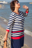 Pretty elderly woman on vacation at seaside Stock Image