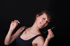 Pretty with electric and ordinary cigarette Stock Photo