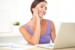 Pretty elegant lady smiling while surfing the web Stock Photo