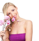 Pretty elegant woman holding an orchid Royalty Free Stock Photo