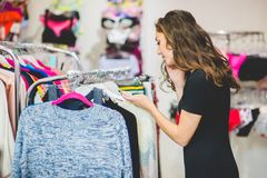 Pretty elegant woman shopping in clothes store Royalty Free Stock Images