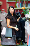 Pretty elegant woman shopping in clothing store Stock Photo