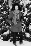 Pretty elegant woman in winter with snow. Black and white, vertical image Stock Image