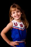 Pretty Elementary Cheerleader Stock Images