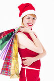 Pretty elf with gifts on white Stock Images