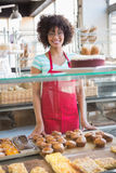Pretty employee posing behind the counter Royalty Free Stock Photo