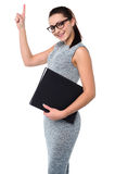 Pretty employee raising her arm up Stock Photos