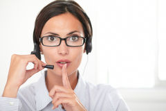 Pretty employee speaking on the headset Royalty Free Stock Image