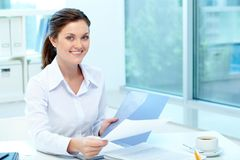 Pretty employer. Portrait of happy employer holding test results and looking at camera stock photos