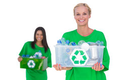 Pretty enivromental activists holding box of recyclables Stock Photography