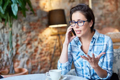 Pretty Entrepreneur Conducting Telephone Negotiations Royalty Free Stock Images