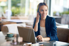 Pretty Entrepreneur Working at Cafe Royalty Free Stock Images