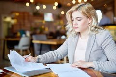 Pretty Entrepreneur Working from Cafe stock image