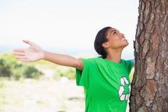 Pretty environmental activist looking up at tree Stock Photos