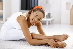 Pretty ethnic girl exercising at home Royalty Free Stock Photography