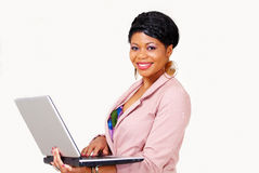 Pretty ethnic lady with laptop smiling Stock Photography