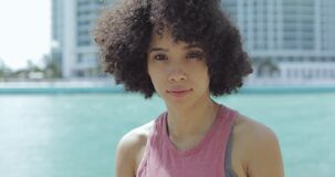 Pretty ethnic woman in sunshine stock video
