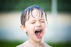 Pretty european little boy shower outdoor Stock Photos
