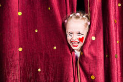 Pretty excited little blond girl on stage Stock Photos
