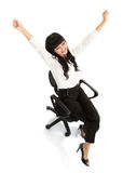 Pretty excited young woman sitting on chair Royalty Free Stock Image